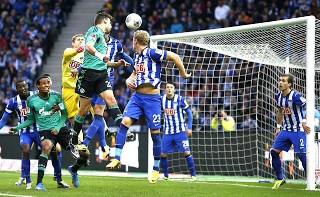 Schalke's Adam Szalai of Hungary, fourth from left, scores the opening goal during the German first division Bundesliga soccer match between Hertha BSC Berlin  and FC Schalke 04 in Berlin, Germany, Sa
