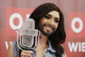 Austria's Conchita Wurst poses with her trophy after a news conference in Vienna