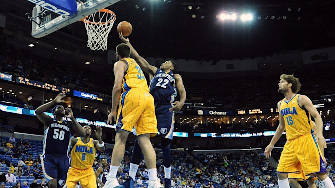 Memphis Grizzlies forward Rudy Gay (22) shoots over New Orleans Hornets center Ryan Anderson (33) during the first half of an NBA basketball game in New Orleans, Friday Dec 7, 2012. (AP Photo/Stacy Revere)