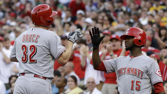 Cincinnati Reds' Jay Bruce (32) is greeted by teammate Derrick Robinson (15) after hitting a solo home run off Pittsburgh Pirates starting pitcher Wandy Rodriguez during the fourth inning of a baseball game in Pittsburgh on Friday, May 31, 2013. (AP Photo/Gene J. Puskar)