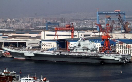 <p>China's first aircraft carrier, the Liaoning, is berthed at the northeastern port of Dalian in September. China has conducted the first landing of a fighter jet on its new aircraft carrier in a move that extends Beijing's ability to project its growing military might in territorial disputes.</p>