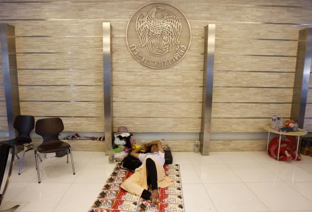Anti-government protester sleeps during a rally at Thailand's Finance Ministry in central Bangkok