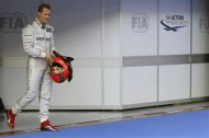 Mercedes Formula One driver Michael Schumacher of Germany walks in parc ferme after the qualifying session of the Malaysian F1 Grand Prix at Sepang International Circuit outside Kuala Lumpur in this March 24, 2012 file photo. REUTERS/Tim Chong/Files