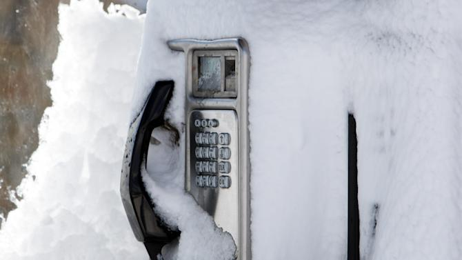 A telephone covered in snow at  Tow Law, England, Wednesday, April 4, 2012. Parts of Scotland and northern England have received 20 centimeters (8 inches) of snow, and 10,000 homes are without power in northeast England after wind brought down power cables.   (AP Photo/Scott Heppell)