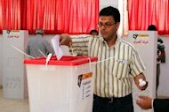 A Benghazi resident casts his ballot on May 19 to elect a local council. An announcement about Libya's national elections will be made on Sunday, an official says
