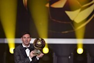FIFA Ballon d'Or award winner Barcelona's Argentinian forward Lionel Messi poses with the trophy after the FIFA Ballon d'Or awards ceremony at the Kongresshaus in Zurich on January 7, 2013