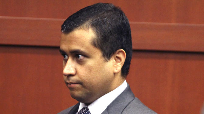 FILE -In this Friday, June 29, 2012 file photo, George Zimmerman enters the courtroom before he appears before Circuit Judge Kenneth R. Lester, Jr., during a bond hearing at the Seminole County Criminal Justice Center in Sanford, Fla. Zimmerman, a neighborhood watch leader was released from jail Friday, July 6, 2012, for a second time while he awaits his second-degree murder trial for fatally shooting Trayvon Martin. (AP Photo/Orlando Sentinel, Joe Burbank, Pool, File)
