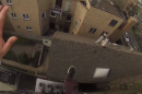 Watch this crazy GoPro video of a man leaping off a four-story building