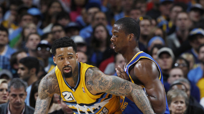 Denver Nuggets forward Wilson Chandler, left, works the ball inside for a shot as Golden State Warriors forward Harrison Barnes covers in the first quarter of Game 2 of the teams' NBA first-round playoff series in Denver on Tuesday, April 23, 2013. (AP Photo/David Zalubowski)