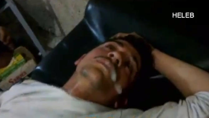 In this screen shot from amateur video provided by Ronahi TV, a man foams at the mouth and twitches while lying on a stretcher at a hospital in Syria. The video is consistent with AP reporting of an attack in the Sheikh Maqsoud neighborhood in Aleppo on April 13, although it was not known if the symptoms resembled those triggered by a chemical weapons attack. A defense analyst who viewed the video of the victims lying on stretchers after the attack said that, while it was impossible to verify that a nerve agent caused their symptoms, they appeared to be the result of something other than traditional weaponry. (AP Photo/Ronahi TV) RONAHI TV IS A KURDISH NETWORK, IT IS NOT A RECOGNISED NEWS GATHERING ORGANISATION. THE ASSOCIATED PRESS CANNOT INDEPENDENTLY VERIFY THE CONTENT, DATE, LOCATION OR AUTHENTICITY OF THIS MATERIAL