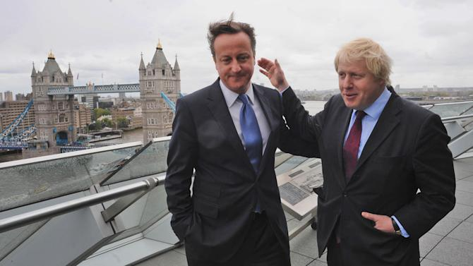 British Prime Minister David Cameron and London Mayor Boris Johnson, right, at City Hall, London, following Johnson's re-election as the Mayor of London Saturday May 5, 2012. London's comic and outspoken mayor Boris Johnson won re-election Friday, triumphing in a closer-than-expected vote to secure a second term and his status as the unvarnished and unpredictable host of the 2012 Olympics   (AP Photo/Stefan Rousseau/PA Wire)