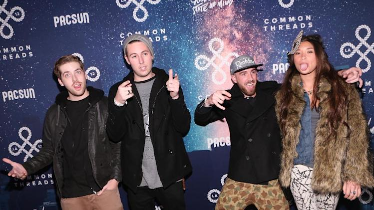 """Right, Drama and Jocelyn Chew arrive at PacSun's """"Common Threads"""" event held at Lot 613 Saturday, December 1, 2012. (Photo by Casey Rodgers/Invision for PacSun/AP Images)"""