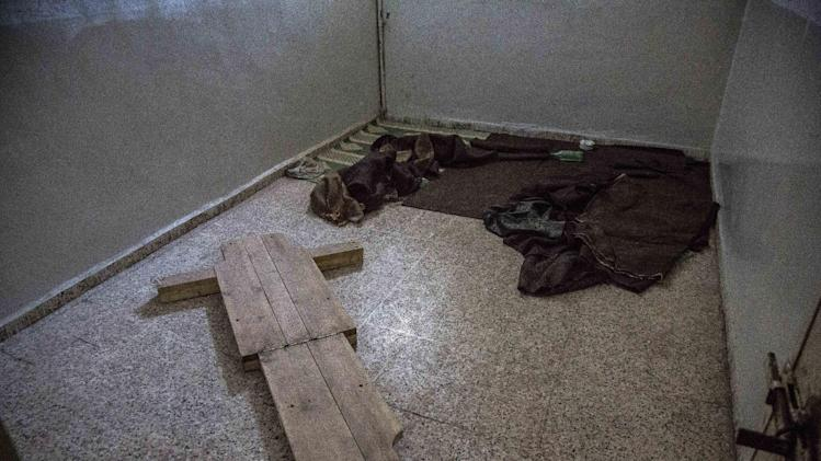 This April 24, 2013 photo released by Human Rights Watch shows a torture device abandoned on the floor of a State Security building, in Raqqa, Syria. Rights activists visiting abandoned government prisons in the first Syrian city to come under rebel control have found torture devices and other evidence that detainees were abused there, Human Rights Watch said in a report Friday. (AP Photo/Bryan Denton for Human Rights Watch)
