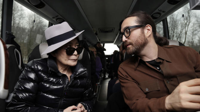 Yoko Ono, left, and her son Sean Lennon chat aboard a bus on the way to visit fracking sites in Pennsylvania,  Thursday, Jan. 17, 2013. They are on a tour of natural-gas drilling sites in northeastern Pennsylvania and plan to visit with residents who say they've been harmed by the controversial extraction process known as fracking. (AP Photo/Richard Drew)