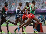 Britain's Mohamed Farah (C) competes in the men's 5000m final at the athletics event of the London 2012 Olympic Games. Farah timed 13min 41.66sec, with Ethiopian Dejen Gebremeskel taking silver in 13:41.98 and Kenya's Thomas Longosiwa claiming bronze (13:42.36)