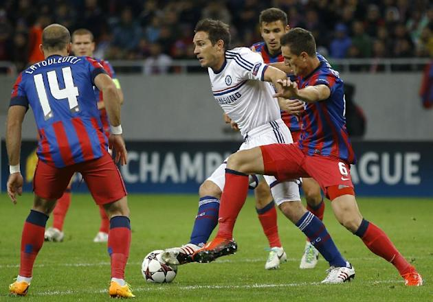 Chelsea's Frank Lampard, center, is challenged by Steaua's Florin Gardos, right, during the soccer Champions League group E match between Steaua Bucharest and Chelsea in Bucharest, Romania, Tuesday, O