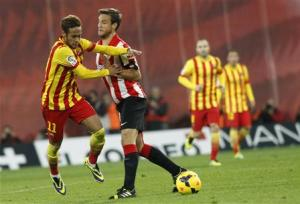 Barcelona's Neymar is challenged by Athletic Bilbao's Gurpegui during their Spanish first division soccer match in Bilbao