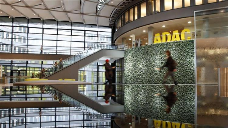People walk inside the ADAC headquarter in Munich