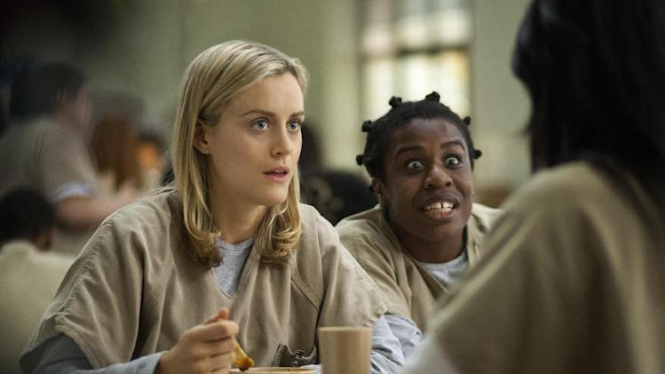 "FILE - This image released by Netflix shows Taylor Schilling, left, and Uzo Aduba in a scene from ""Orange Is the New Black."" (AP Photo/Netflix, Paul Schiraldi, File)"