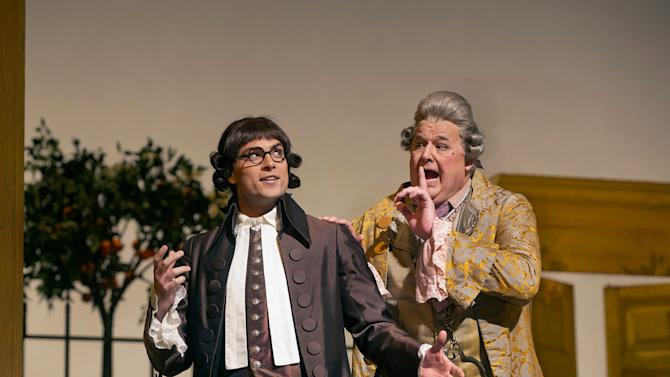 """In this Dec. 14, 2012 publicity photo, Alek Shrader as Count Almaviva (in disguise as Don Alonso) and John Del Carlo as Dr. Bartolo are seen in Rossini's """"The Barber of Seville,"""" during rehearsal at the Metropolitan Opera in New York. (AP Photo/Metropolitan Opera, Ken Howard)"""