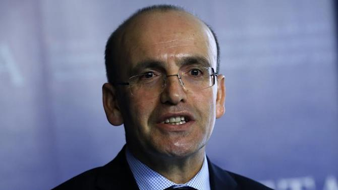 Simsek speaks during a meeting in Ankara