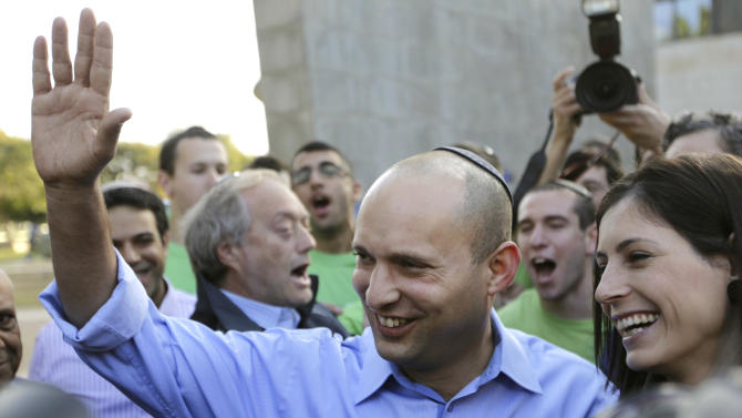 Naftali Bennett, head of Israel's Jewish Home party, left, waves to a crowd as he leaves a polling station after voting in Raanana, Israel, Tuesday, Jan. 22, 2013. Israelis began trickling into polling stations Tuesday morning to cast their votes in a parliamentary election expected to return Prime Minister Benjamin Netanyahu to office despite years of stalled peacemaking with the Palestinians and mounting economic troubles. (AP Photo/Ariel Schalit)