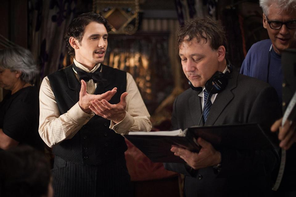 "This film image released by Disney Enterprises shows James Franco, left, and director Sam Raimi on the set of ""Oz the Great and Powerful."" (AP Photo/Disney Enterprises, Merie Weismiller Wallace)"