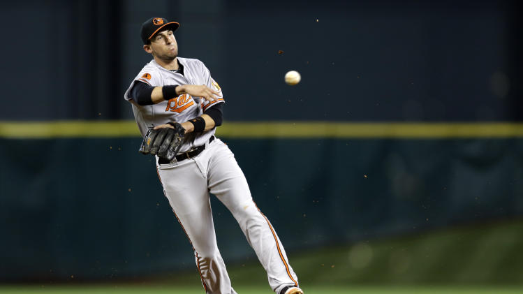 Baltimore Orioles second baseman Ryan Flaherty throws to first after fielding a ground ball hit by Houston Astros' Jimmy Paredes during the second inning of a baseball game Tuesday, June 4, 2013, in Houston. Paredes was out at first on the play. (AP Photo/David J. Phillip)