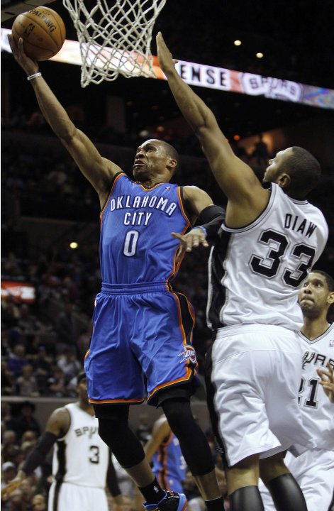 Oklahoma Thunder Westbrook goes to the basket against San Antonio Spurs Diaw during their NBA game in San Antonio, Texas
