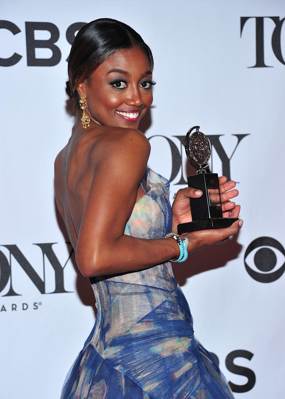 "Patina Miller poses with her award for best actress in a musical for ""Pippin"" in the press room at the 67th Annual Tony Awards, on Sunday, June 9, 2013 in New York.  (Photo by Charles Sykes/Invision/AP)"