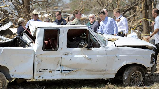Texas Governor Rick Perry, right, tours the storm-damaged Rancho Brazos Estates subdivision near Granbury, Texas, on Friday May 17, 2013. On Wednesday, powerful storms produced 16 tornadoes in the area that left six dead. (AP Photo/The Fort Worth Star-Telegram, Max Faulkner)  MAGS OUT; (FORT WORTH WEEKLY, 360 WEST); INTERNET OUT