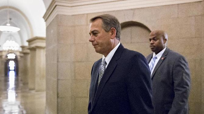 House Speaker John Boehner of Ohio arrives on Capitol Hill in Washington, Monday, Oct. 7, 2013. The Republican-controlled House and the Democrat-controlled Senate are at an impasse, neither side backing down, after House GOP conservatives linked the funding bill to President Obama's existent health care law. (AP Photo/J. Scott Applewhite)