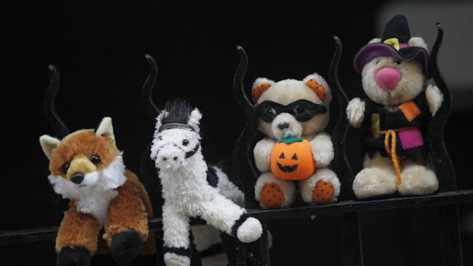 Stuffed animals are placed on a fence at a memorial outside the apartment building of the two children allegedly stabbed by their nanny, Saturday, Oct. 27, 2012 in New York.  The 2-year-old son and 6-year-old daughter of a CNBC executive were found dead by their mother in a dry bathtub in the family's Upper West Side apartment Thursday night. The nanny suspected of stabbing the children was in critical condition Friday with apparently self-inflicted injuries. (AP Photo/Mary Altaffer)