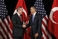 U.S. President Barack Obama with Prime Minister of Turkey Recep Tayyip Erdogan during their bilateral meeting in Seoul, South Korea, Sunday, March, 25, 2012. (AP Photo/Pablo Martinez Monsivais)