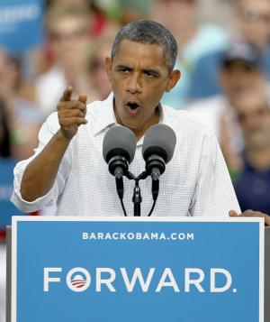 President Barack Obama addresses the crowd during a campaign stop Wednesday, Aug. 15, 2012, in Davenport, Iowa. (AP Photo/Charles Rex Arbogast)