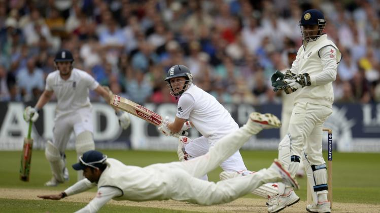 England's Ballance looks on as India's Rahane attempts to stop the ball during the first cricket test match at Trent Bridge cricket ground in Nottingham