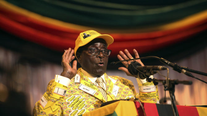 "Zimbabwean President Robert Mugabe delivers his speech at  his party's 13th annual conference, in Gweru about 250 Kilometres south west  of the capital Harare, Friday, Dec. 7, 2012 .Zimbabwe president's loyalists have converged for an annual party convention in the provincial city of Gweru, hoping to map out a winning election strategy to end a conflict-ridden four-year-old coalition. President Robert Mugabe said in the state media Friday the convention should prepare for a convincing victory ""that will leave no room for doubt."" The longtime leader has said he wants elections in March, a target that doesn't seem realistic. (AP Photo/Tsvangirayi Mukwazhi)"