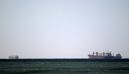 Oil tankers cruise out of the Strait of Hormuz off the shores of Tibat in Oman in January 2012. Iranian MPs have signed a draft law aimed at banning Europe-bound oil tankers from using the Strait of Hormuz to punish EU nations that slapped sanctions on the Islamic republic, reports said on Monday