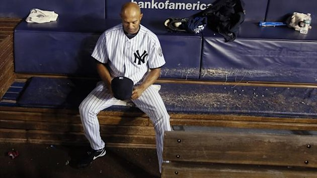 New York Yankees relief pitcher Mariano Rivera sits alone on the bench after the Tampa Bay Rays beat the Yankees in their MLB American League game at Yankee Stadium in New York (Reuters)
