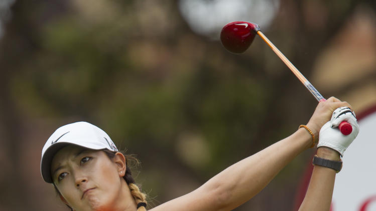 Michelle Wie of Honolulu watches her drive off the first tee in the third round of the LPGA Lotte Championship golf tournament at the Ko Olina Golf Club Friday, April 19, 2013, in Kapolei, Hawaii. (AP Photo/Eugene Tanner)
