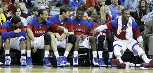 Johnson leads No. 3 Kansas in rout of Texas A&M