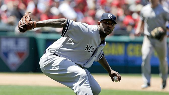 New York Yankees starting pitcher CC Sabathia fails to throw Los Angeles Angels' Mike Trout out at first during the sixth inning of a baseball game in Anaheim, Calif., Sunday, June 16, 2013. (AP Photo/Chris Carlson)
