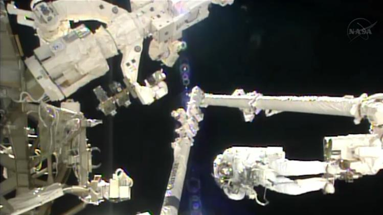 In this image made from video provided by NASA, Italian astronaut Luca Parmitano stands on the end of a robotic arm during a spacewalk outside the International Space Station on Tuesday, July 9, 2013. (AP Photo/NASA)