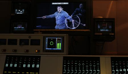 "Opera Singer O'Neill playing the role of Parsifal appears on a screen in the sound room during a live broadcast of the opera ""Parsifal"" from the Royal Opera House in London"