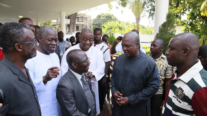 Ghana President John Dramani Mahama, center right, speaks with election observers and ruling party members following a press conference at the presidential residence in Accra, Ghana, Sunday, Dec. 9, 2012. As voting continued for an unplanned second day on Saturday, international observers endorsed Ghana's presidential and parliamentary polls, despite the delays at some polling stations that led to the extended vote. Polls show that a very tight race with voters almost evenly split between President Mahama and his main challenger, Nana Akufo-Addo. (AP Photo/Christian Thompson)