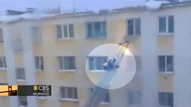Falling snow sends firefighter tumbling down ladder