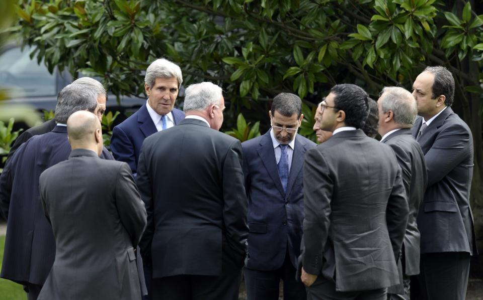 U.S. Secretary of State John Kerry, center left, talks with members of the Arab League Peace Initiative following their meeting at the United States Embassy in Paris, Sunday, Sept. 8, 2013. (AP Photo/Susan Walsh, Pool)