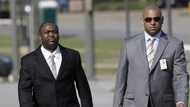 Former Ventress Correctional Facility Lt. Michael Smith, left, arrives at the Federal Building in Montgomery, Ala., with his attorney Stephen Ganter on Tuesday, June 25, 2013. A federal court jury will begin deliberations Tuesday in the trial of the former prison supervisor who is charged with fatally beating an inmate and trying to cover up what happened. (AP Photo/Dave Martin)