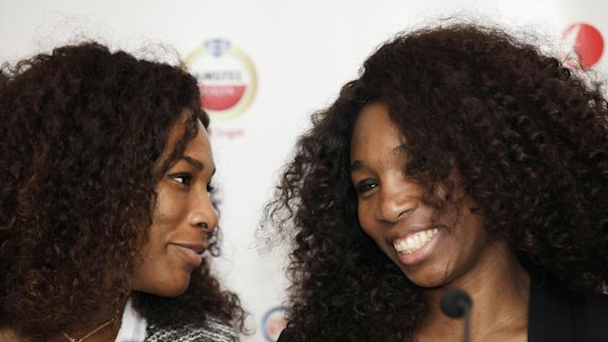 U.S Tennis star Serena Williams, left, and Venus Williams smile during a press conference in Lagos, Nigeria. Wednesday, Oct. 31, 2012. Tennis stars Serena and Venus Williams say they eagerly await playing in the 2016 Olympics after their third doubles gold this year. The two sisters made the comments Wednesday in Lagos, Nigeria's largest city, during their first visit to the country. (AP Photo/Sunday Alamba)