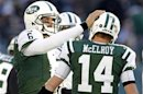 New York Jets quarterback Sanchez pats quarterback McElroy on helmet after scoring drive against the San Diego Chargers during the first quarter of their NFL football game in East Rutherford